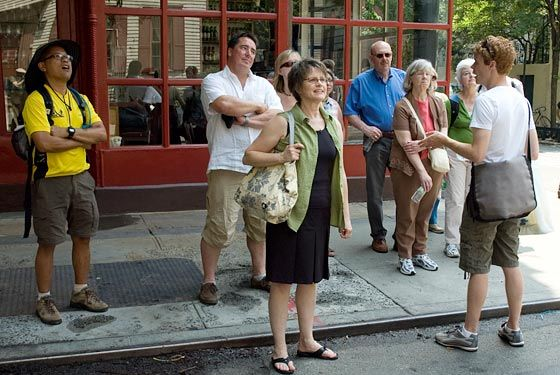 the tour guide walking and talking new york